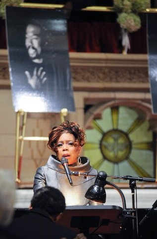 Valerie Simpson swayed back and forth in her seat and smiled during the memorial for...