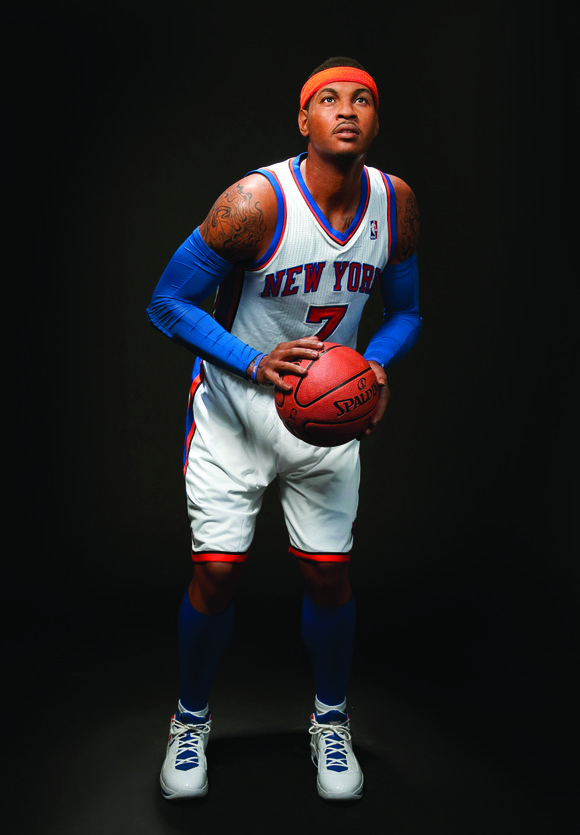 Posed in his Knicks home uniform and his signature size-15 Jordan sneakers, which were donated...