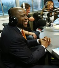 "IMAGE DISTRIBUTED FOR ORASURE - Earvin ""Magic"" Johnson, CEO of Magic Johnson Enterprises, visits Big Boy's Neighborhood at the LA Power 106 studio to discuss the OraQuick In-Home HIV test and the importance of knowing your HIV status on Monday, March 25, 2013 in Burbank, Calif.  (Photo by Matt Sayles/Invision for OraQuick/AP Images)"
