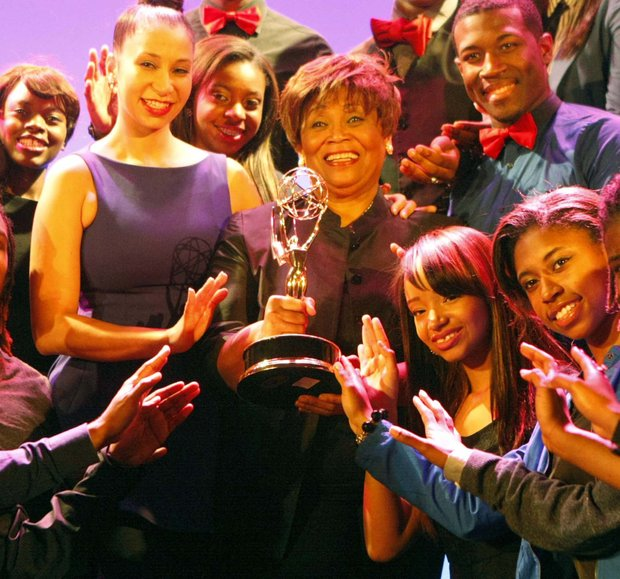 Photo of: Vy Higginsen's season grand opening of two hit plays:  Sing Harlem Sing! and Mama, I Want to Sing at the Dempsey theater, at 127 West 127th Street. Vy and Knolle Higginsen, and their singers showing off the Emmy on stage at the Dempsey theater.  Photo credit: G.N. Miller/New York Post (c) 2012