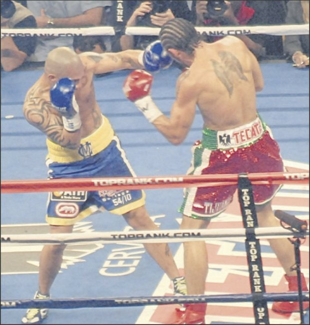 Cotto punches his way to a bloody revenge win over Margarito