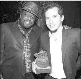 "To celebrate an extra rare moment in Cedric's career (""American Buffalo"" is the comedian/actor's first Broadway play)—Cedric ""The Entertainer"" presented his American Buffalo co-star, John Leguizamo, along with several of the ""American Buffalo"" producers with personalized embroidered Crown Royal XR bags to commemorate the show's opening night on Broadway. Cedric the Entertainer, Haley Joel Osmet and John Leguizamo in ""American Buffalo"""