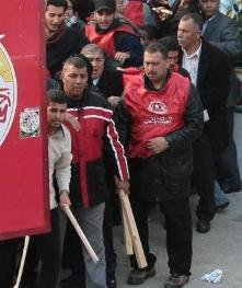 Tunisian workers clash with pro-government supporters