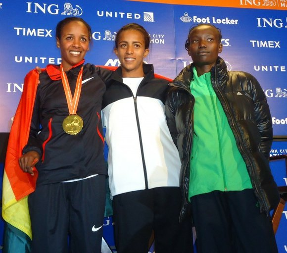 Leg cramps and rib pains didn't stop three women runners from putting on a show...