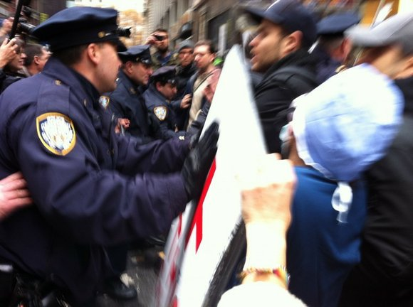 Occupy Wall Street protestors rallied in the hundreds this morning with the goal to shut...