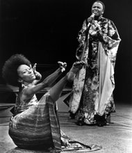 Miriam Makeba sings African songs as Judy Dearing dance.