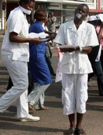 Jun. 11 (GIN) - With tape over their mouths and waving paper plates, Mozambique's doctors...