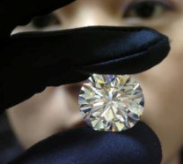 Dec. 6 (GIN) - So-called 'blood diamonds' are again on the market, glittering in the...