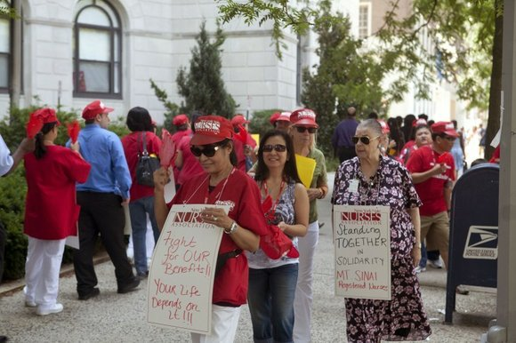Nurses at the Terence Cardinal Cooke Health Care Center in Manhattan and members of the...