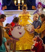 "Each portraying a character from the Disney animated classic  ""Beauty and the Beast,""  Magic Kingdom guests join Belle and Lumiere in a fun-filled storytelling adventure at Enchanted Tales with Belle. Part of New Fantasyland, Enchanted Tales with Belle will grand open Dec. 6, 2012 at Walt Disney World Resort in Lake Buena Vista, Fla. (Kent Phillips, photographer)"