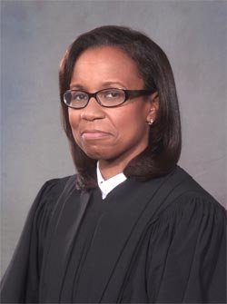 US District Court Judge Denise J. Casper was selected...