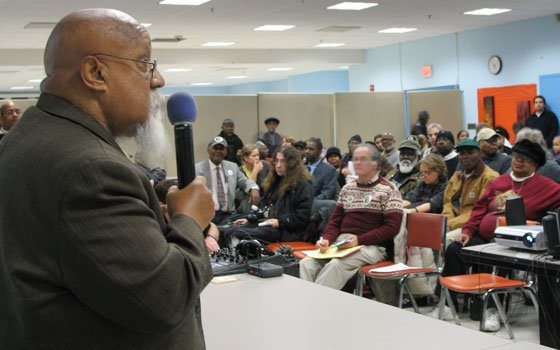 City Councilor Chuck Turner speaks to attendees at a rally held at Roxbury Community College last week in...