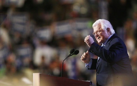 Sen. Edward M. Kennedy, D-Mass., greets the crowd at the Democratic National Convention in Denver on Monday, Aug....