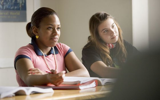 Commonwealth School seniors Symone Williams (left) and Lauren Derosa listen in class. Williams says the biggest thing that...