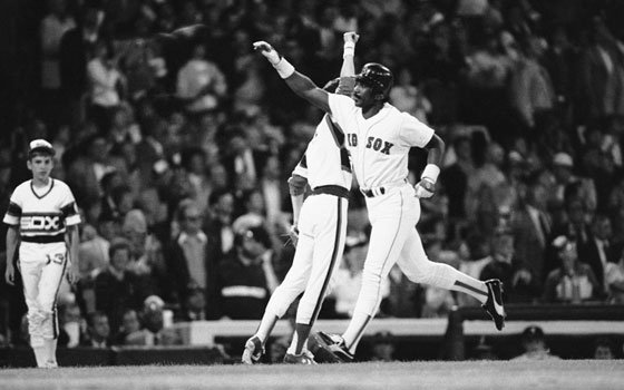 Boston Red Sox outfielder Jim Rice is congratulated by an American League teammate after he hit a home...