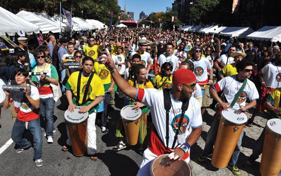 The rumbling drums of Bloco AfroBrazil, a samba-inflected parade of percussionists and dancers led by Marcus Santos, provided a...