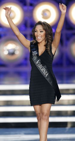 Miss Virginia Caressa Cameron reacts as she is named a...