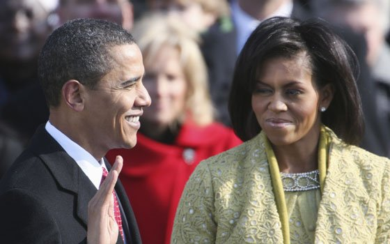 First lady Michelle Obama (right) watches as her husband Barack Obama is sworn in as the 44th president...