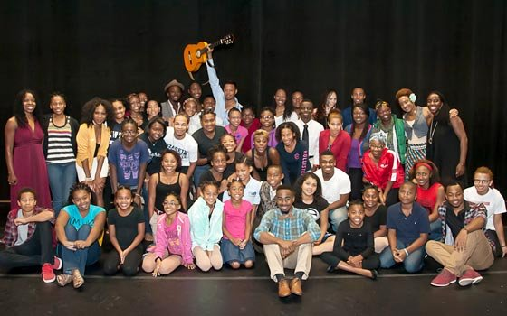 Actor Terrence Howard poses with young dancers from OrigiNation prior to their performance at Twist...
