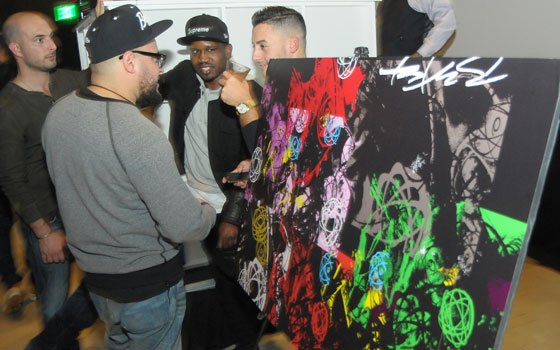 Partygoers check out Futura's work, specially created for his stop in Boston. (John Brewer photos) ...