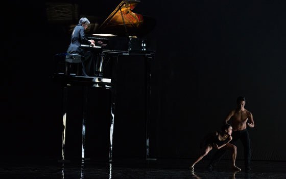 Pianist Tomoko Mukaiyama with Boston Ballet dancers John Lam and Lia Cirio in Jirí Kylián's...