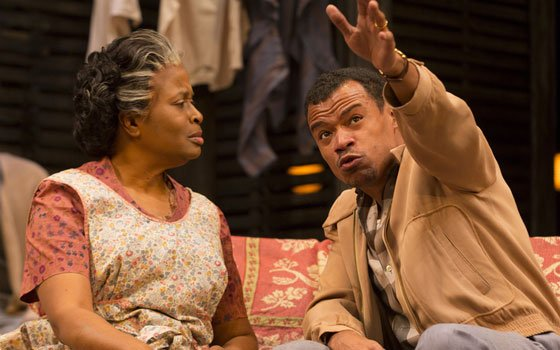 "Kimberly Scott and LeRoy McClain in the Huntington Theatre Company production of Lorraine Hansberry's ""A Raisin in The Sun."""