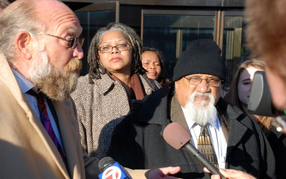 City Councilor Chuck Turner (right) and defense attorney Barry Wilson (left) speak to members of the media outside...