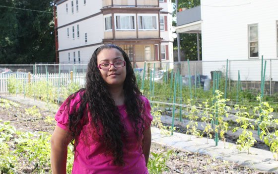 Lizette Varela stands on a garden plot at ReVision Urban Farm in Dorchester. Varela works on the farm and...