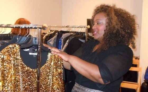 Pop Up Plus founder Cami Newman rearranges racks of curve-friendly clothing at last weekend's plus-sized fashion...