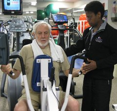 Marlene DaCosta (right), exercise physiologist and assistant manager of the Tanger Be Well Center at Beth Israel Deaconess Medical Center, helps arthritis sufferer Warner Slack, M.D., with his exercise regime.