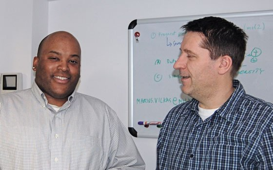 Keith Donaldson, CEO and principal investigator of the Cambridge-based technology company MolySym (left), talks with senior software engineer...