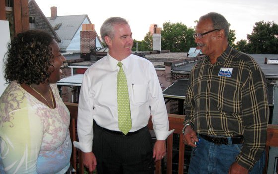 City Councilor-at-Large Michael F. Flaherty (center) chats with Corlis Melchoir (left) and Steve Johnson on the rear deck...