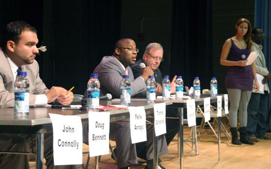 At-large City Council candidate Tito Jackson second from left answers a question as rivals Felix Arroyo left, At-Large City Councilor Steven Murphy third from left and youth leaders Melissa Abar second from right and Calvin Carrasquillo right listen during a candidates' forum at English High School last week.