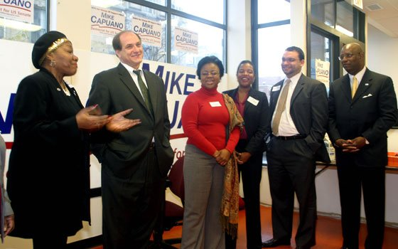 State Rep. Gloria Fox introduces Congressman Michael Capuano during the opening of his campaign's Dudley Square office. Looking...
