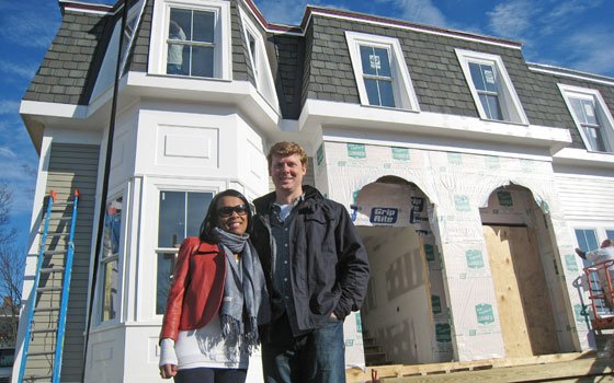 "Soon-to-be homeowner Lanita Tolentino poses with ""This Old House"" host Kevin O'Connor on an early December site visit to..."