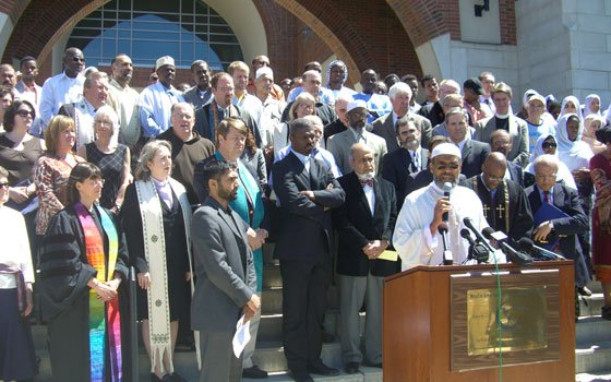 Imam Abdullah Faaruuq from Roxbury's Mosque for the Praising of Allah speaks before an audience of religious leaders...
