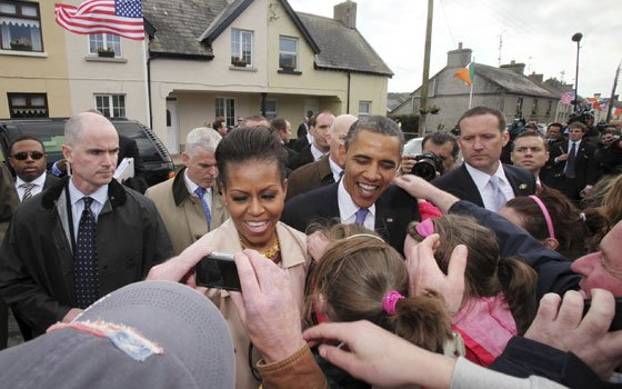 U.S. President Barack Obama and first lady Michelle Obama met local residents in Moneygall, Ireland, the ancestral homeland...