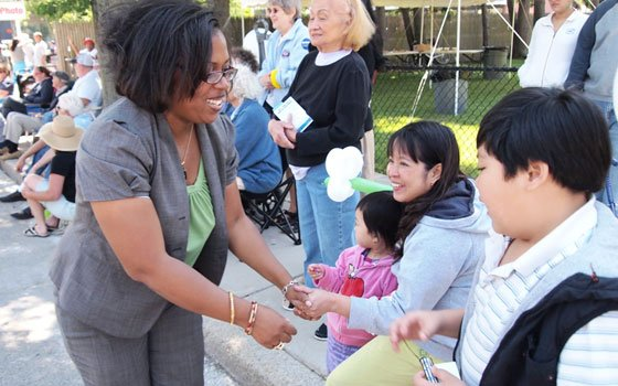 City Council District 3 candidate Stephanie Everett greets potential and future voters during the Dorchester Day Parade. Seven candidates...