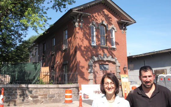 Historic Boston Incorporated Executive Director Kathy Kottaridis and Construction Supervisor Brian Gossens in front of the Eustice Street...