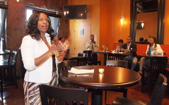 At-large City Councilor Ayanna Pressley talks to supporters during a fundraiser last week. Pressley is campaigning for re-election to her second term in the City Council.