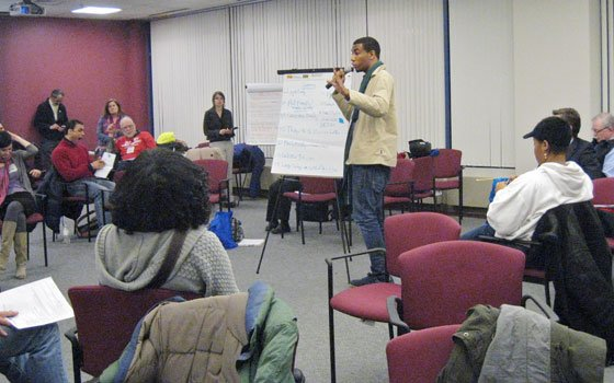 The Boston Transportation Department held a public meeting Dec. 14 to discuss improvements to Melnea Cass Boulevard. Here, a meeting attendee presents some ideas his group compiled in a brainstorming breakout session.