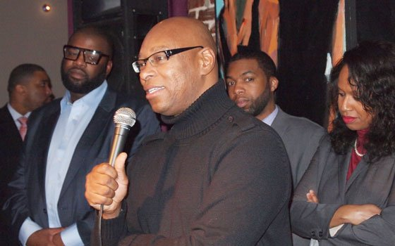 Restaurateur Darryl Settles addresses a gathering at the Live the Dream event held at Darryl's Corner Bar and Kitchen....