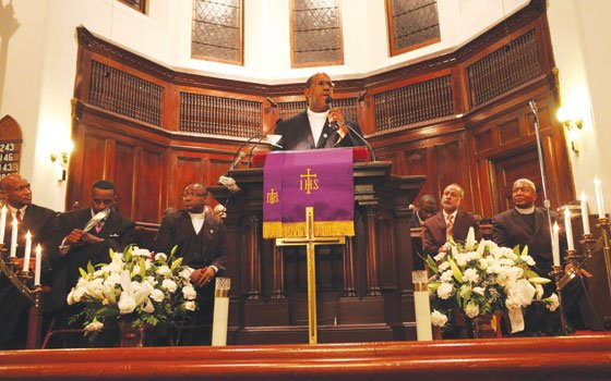 Charles Street AME pastor Gregory G. Groover Sr. tells the crowd of supporters that he appreciates their support....