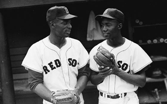 Pumpsie Green (R) was the first African American to play for the Red Sox. He is shown here...