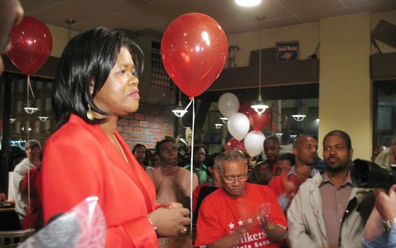 State Sen. Dianne Wilkerson pauses while supporters applaud during her concession speech, delivered Tuesday night at the Hen...