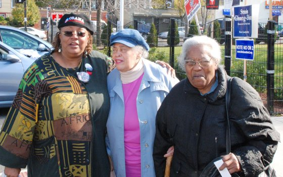 Queen Gloria Johnson, Barbara Toney and Corine Wilkins stand outside the Yawkey Club in Roxbury after casting their...