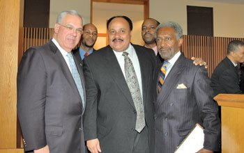 Martin Luther King III (center), son of Dr. Martin Luther King...