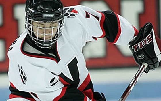 "On the ice for Northeastern University's women's hockey team, Missy Elumba was a ""digger,"" responsible for banging in..."