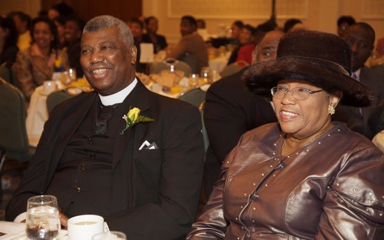 The Rev. Dr. LeRoy Attles (left) shares a laugh with his wife, Henrietta, at the 22nd Annual Martin...