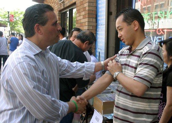 Tomas Gonzalez (left), a former Latino community liaison for Mayor Thomas M. Menino and one of 15 candidates...